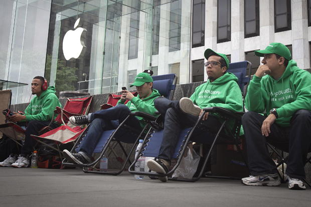 People line up outside the Apple Store in advance of an Apple special event, in the Manhattan borough of New York