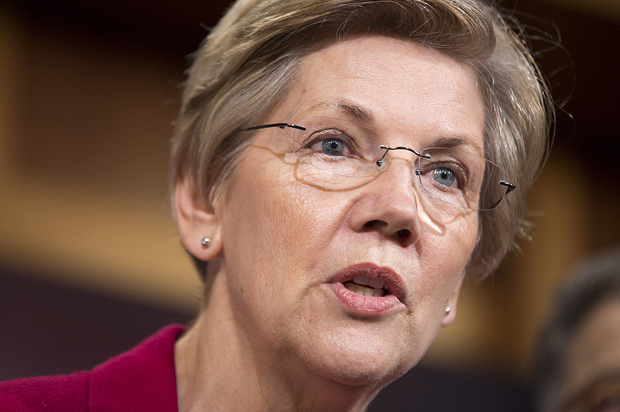 Senator Elizabeth Warren (D-MA) speaks at a news conference to warn about the abolishment of Consumer Financial Protection Bureau in the proposed budget put forward by Senate Republicans on Capitol Hill in Washington March 25, 2015.      REUTERS/Joshua Roberts - RTR4UUSY