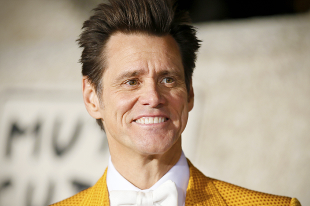 "Actor Jim Carrey poses at the world premiere of the film ""Dumb and Dumber To"" in Los Angeles, November 3, 2014.   REUTERS/Danny Moloshok   (UNITED STATES - Tags: ENTERTAINMENT) - RTR4CPH0"