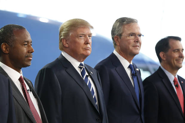 Republican U.S. presidential candidates including (L-R) Dr. Ben Carson, businessman Donald Trump, former Florida Governor Jeb Bush and Wisconsin Governor Scott Walker pose for a group photo before the start of the second official Republican presidential candidates debate of the 2016 U.S. presidential campaign at the Ronald Reagan Presidential Library in Simi Valley, California, September 16, 2015.   REUTERS/Mario Anzuoni - RTS1HJJ