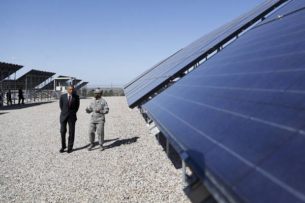 U.S. President Barack Obama takes a tour of a solar power array before delivering remarks on clean energy at Hill Air Force Base, Utah April 3, 2015. Obama announced a Department of Energy initiative Friday with the goal of training 75,000 workers, especially targeting veterans, to enter the solar energy workforce by the year 2020.REUTERS/Jonathan Ernst - RTR4W1B3