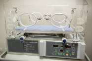Closeup of infant incubator technology in a medical center hospital