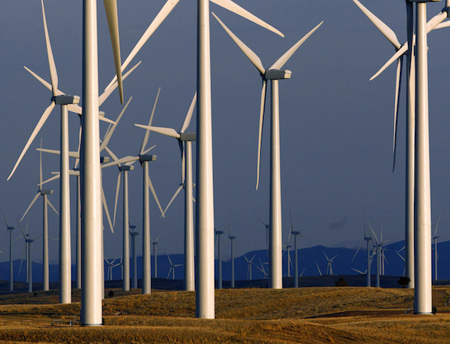 FILE - This May 6, 2013 file photo shows a wind turbine farm near Glenrock, Wyo. The growth of renewable energy outpaced that of fossil fuels in the electricity sector last year, with a record 135 gigawatts of capacity added from wind, solar, hydropower and other natural sources, a new study shows. The annual report released early Thursday, June 18, 2015 in Europe by Paris-based REN21, a non-profit group that promotes renewable energy, underscored how China, the world's top consumer of coal, has become a global leader in clean energy, too. (AP Photo/Matt Young, File)