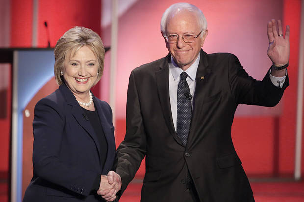 Democratic presidential candidate, Hillary Clinton and Democratic presidential candidate, Sen. Bernie Sanders, I-Vt,  shakes hands as they greet the audience before the audience before a Democratic presidential primary debate hosted by MSNBC at the University of New Hampshire Thursday, Feb. 4, 2016, in Durham, N.H. (AP Photo/David Goldman)