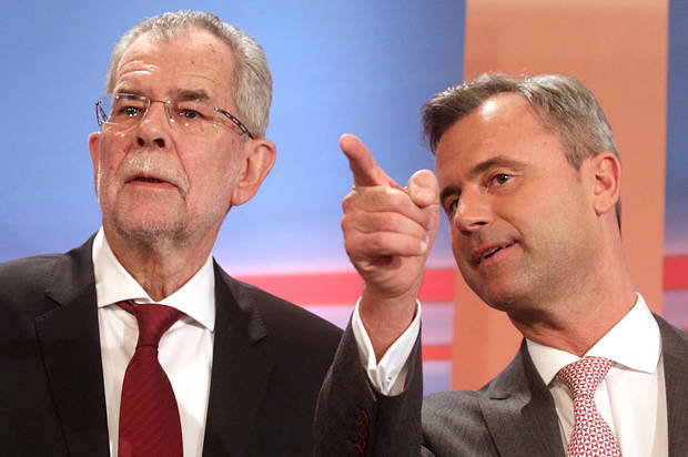 Norbert Hofer, right, candidate for presidential elections of Austria's Freedom Party, FPOE, talks to Alexander Van der Bellen, left, candidate for presidential elections and former head of the Austrian Greens during the release of the first election results of the Austria presidential elections in Vienna, Austria, Sunday, April 24, 2016. (AP Photo/Ronald Zak)